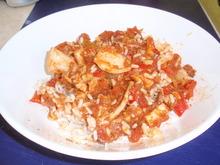 Ριζότο με φρέσκα καλαμαράκια και κόκκινη σάλτσα
