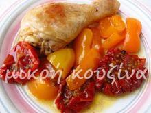 Κοτόπουλο με βινσάντο, πιπεριές και λιαστές ντομάτες Σαντορίνης