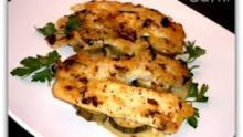 Ψάρι στο φούρνο με σάλτσα και κίτρινο τυρί