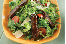Fresh salad with rocket and beef steak