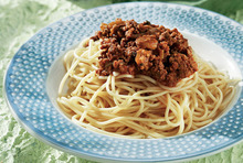 Traditional spaghetti with lamb minced meat and feta cheese