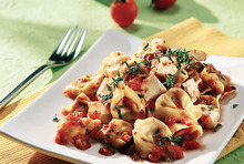 Tortellini of meat in a fragrant sauce with haloumi or mastelo cheese